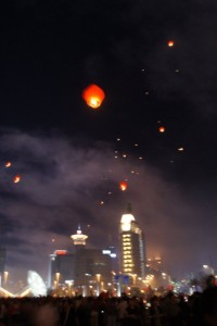 Our Moon Festival lantern (top center) floating into the sky with a bit of the Shanghai skyline in the background