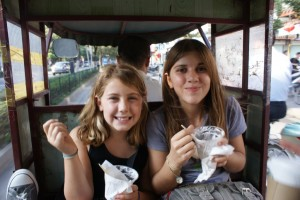 The girls leisuring enjoying ice cream in the tuktuk (before they had to put the ice cream cups down to hold on for their lives!)
