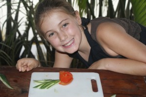 "Phoebe after finishing the ""garnishing"" lesson at cooking school - oh so Montessori!"