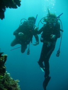 "Dad and I diving ""Rico's Wall"" at about 12 meters - check out my awesome 5mil wetsuit - I was STILL FREEZING!"