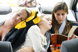 "Olivia & Phoebe sleeping off their motion sickness pill in the back of our luxurious ""Sunny Salon"" economy car.  This is how we traveled for the whole month - jammed in this tiny car - we looked clowns getting out of it!"