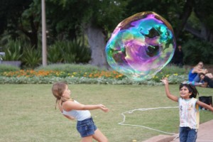 A street perfomer in Sydney blew these giant bubbles, Phoebe entertained the crowd by blowing the huge bubbles around