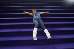 Tessa on the purple stairs in the opera house