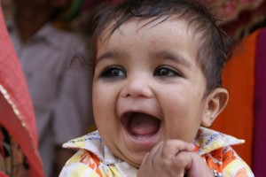 In India, some people put eyeliner on the little babies because they think it makes their eyes look bigger.  But their eyes are big to begin with!