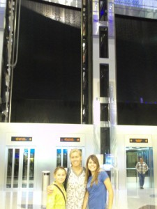The girls infront of the lift, notice the waterfall in upper background.  I could only get in two of the elevators.
