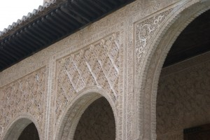 The Palace was a beautiful building with very ornate carvings, lots of pretty arches, fountains, amazing tile work, and great views.  Here is an arch with some carvings from afar...